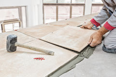 Floor tile installation Stock Photos