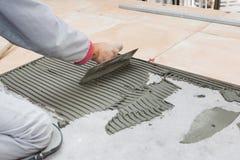 Floor tile installation stock image