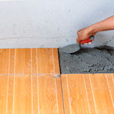 Floor tile installation for house building Royalty Free Stock Image
