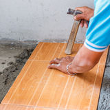 Floor tile installation for house building Stock Photography