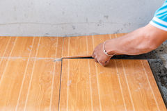 Floor tile installation for house building Stock Image