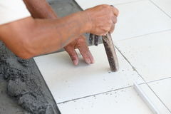 Floor tile installation for house building Royalty Free Stock Photos
