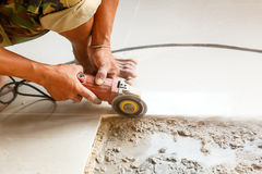 Floor tile installation for house building Stock Images