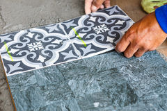 Floor tile installation for house building Royalty Free Stock Photography