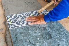 Floor tile installation for house building Stock Photos