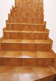 Floor tile stairs. Stairway with brown floor tiles royalty free stock photos
