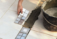 Floor tiler  at work Royalty Free Stock Photo