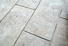 Floor tiles. Floor white tiles as background Stock Photography