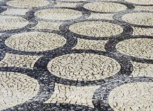 Floor tiles. With decoration circular central street of Lisbon Stock Images