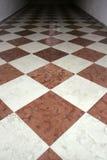 Floor tiles. Beige and brown floor tiles in hallway royalty free stock photo