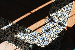 Floor tiles. Abstract photo with floor and foot Stock Photos