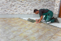 Floor tiles installation Stock Photos
