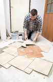 Floor tiles installation Royalty Free Stock Photos