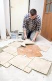 Floor tiles installation Royalty Free Stock Photos