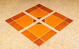 Floor tiles. Mixing tiles and small rock floor in orange tone royalty free stock photography