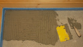 Floor Tiling Adhesive and Trowel Royalty Free Stock Photos