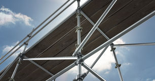 Floor view of 3D scaffolding whit the sky. Digital composite of floor view of 3D scaffolding whit the sky Stock Image