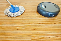 Floor washing robot and traditional mop 1 Stock Image