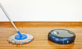 Floor washing robot and traditional mop 2 Stock Image