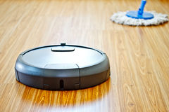 Floor washing robot with traditional mop Royalty Free Stock Photo