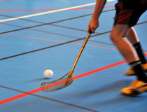 Floorball action. Ball and club during a floorball game Royalty Free Stock Photos