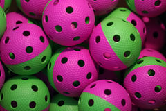 Floorball balls. Green and violet floorball balls Royalty Free Stock Image