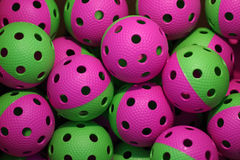 Floorball balls. Many purple-green floorball balls Royalty Free Stock Images