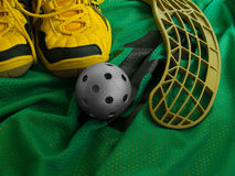 Floorball Equipment 3. Floorball ball, stick, and shoes on a green jersey Royalty Free Stock Photos