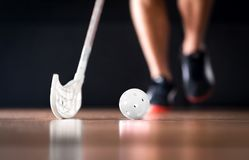 Floorball or floor hockey concept. Player running with ball and stick. royalty free stock photography