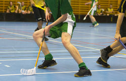 Floorball game. Player has the ball stock photo