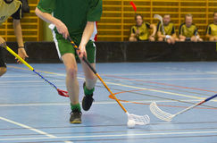 Floorball game. Player has the ball stock photography