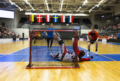 Floorball Game. Crowded arena - Goalie makes a great save royalty free stock photo