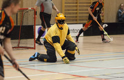 Floorball Goalie. In a yellow uniform royalty free stock photos