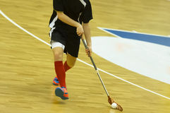 Floorball. Player handling the ball stock photo