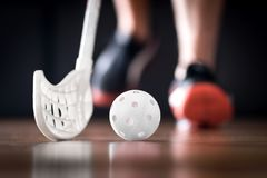 Floorball player running with ball and stick. Floor hockey concept. royalty free stock images