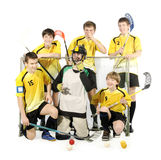 Floorball players and goalkeeper. On the white background Royalty Free Stock Photo