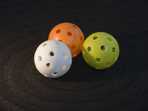 Floorball. Three floorball balls on black background Royalty Free Stock Images