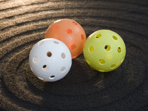 Floorball. Three colored floorball balls on black background Stock Photo