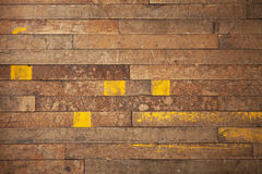 Wood Industrial Grunge Background. A very worn and used wood background with blocks of yellow paint Royalty Free Stock Photo