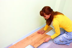 Flooring with laminated board. A woman laying on a floor with laminated flooring boards Stock Photo