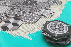 Flooring - laying hexagon floor tiles Royalty Free Stock Photo