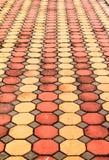 Flooring. Tiles. Brick sidewalk bordering the road Stock Images