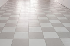 Flooring tiles  moving away in perspective Stock Images