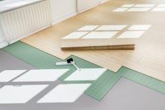 Flooring - wooden floor being but in home stock illustration