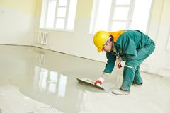 Flooring works with self-levelling mortar Royalty Free Stock Images