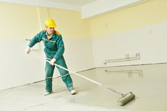 Flooring works with self-levelling mortar Stock Photo