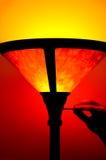 Floorlamp. Turning on a floor lamp Stock Photos