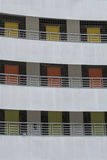 3 floors of different coloured doors in building facade Royalty Free Stock Photography
