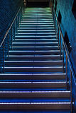 Between the floors staircase with illuminated steps Royalty Free Stock Photo
