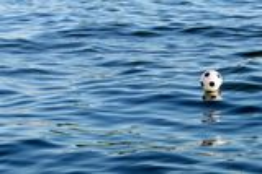 Flootball on blue water surface Stock Photos